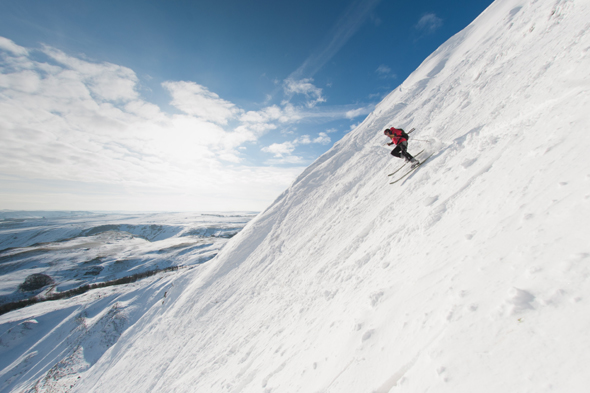 Mandatory Credit: Photo by Alex Messenger/Solent News/REX (4418730a) Skier on Mam Tor Skiers on a snow covered Mam Tor in the Peak District, Derbyshire, Britain - 04 Feb 2015 *Full story: http://www.rexfeatures.com/nanolink/pwnm  These experienced skiers look like they are carving down a mountain in the French Alps - when in fact they are just 20 miles from Sheffield. The adventurous trio travelled to Mam Tor, a 1,695ft hill in the heart of the Peak District, after the country was covered in snow yesterday. When they arrived they were delighted to find the steep hill completely white and coated in fresh powdered snow. The rare moment, which happens 'once every 20 years' because of the wind direction, was caught on camera in the -5 degree Celsius conditions. Photographer Alex Messenger, from Manchester, captured the unique moment when he travelled to the picturesque spot with two ski-ing friends. He described the hill as being like a 'little corner of the Alps', when in reality they were just 30 miles from their home in Manchester.