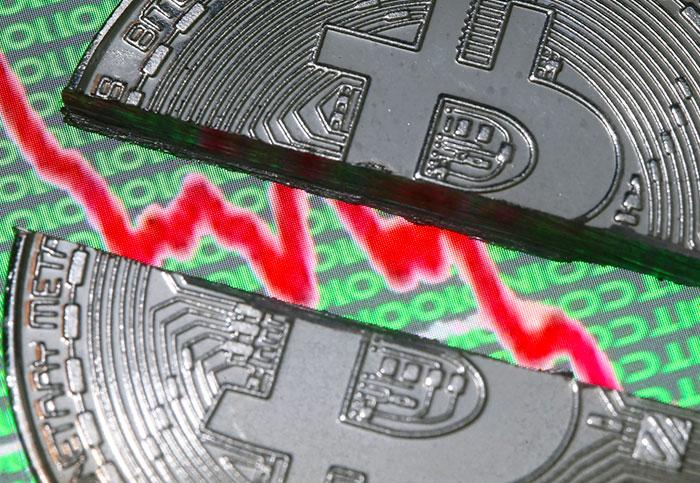 Bitcoin tumbles below $10,000, half of its peak value
