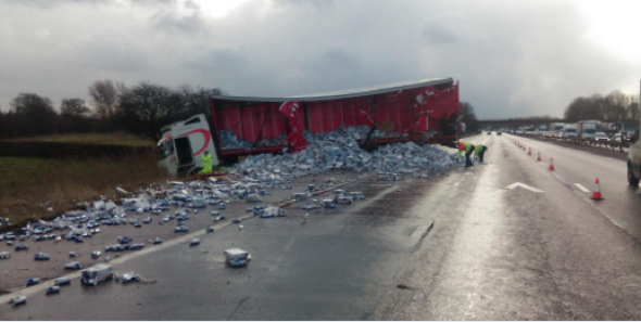 Lorry crash sends thousands of Red Bull cans spilling onto motorway