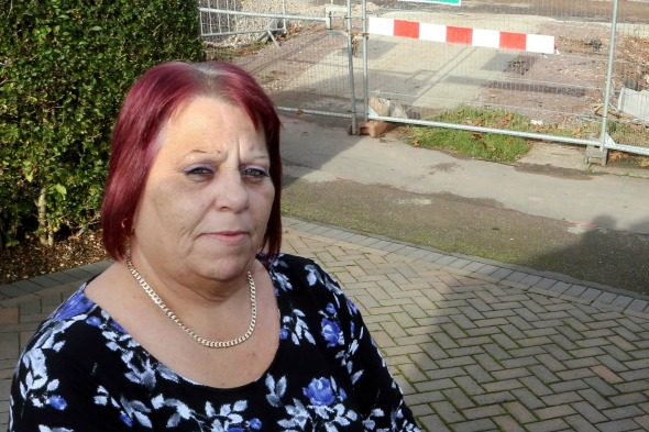 Ksenia Martin, outside her home in Nottingham which has been blocked off due to the redesign of the A453 - the junction has been changed so she will not be able to access the driveway at all. A mum-of-one has blasted council chiefs after being permanently cut off from her own home because workmen are building a roundabout - at the end of her DRIVEWAY.