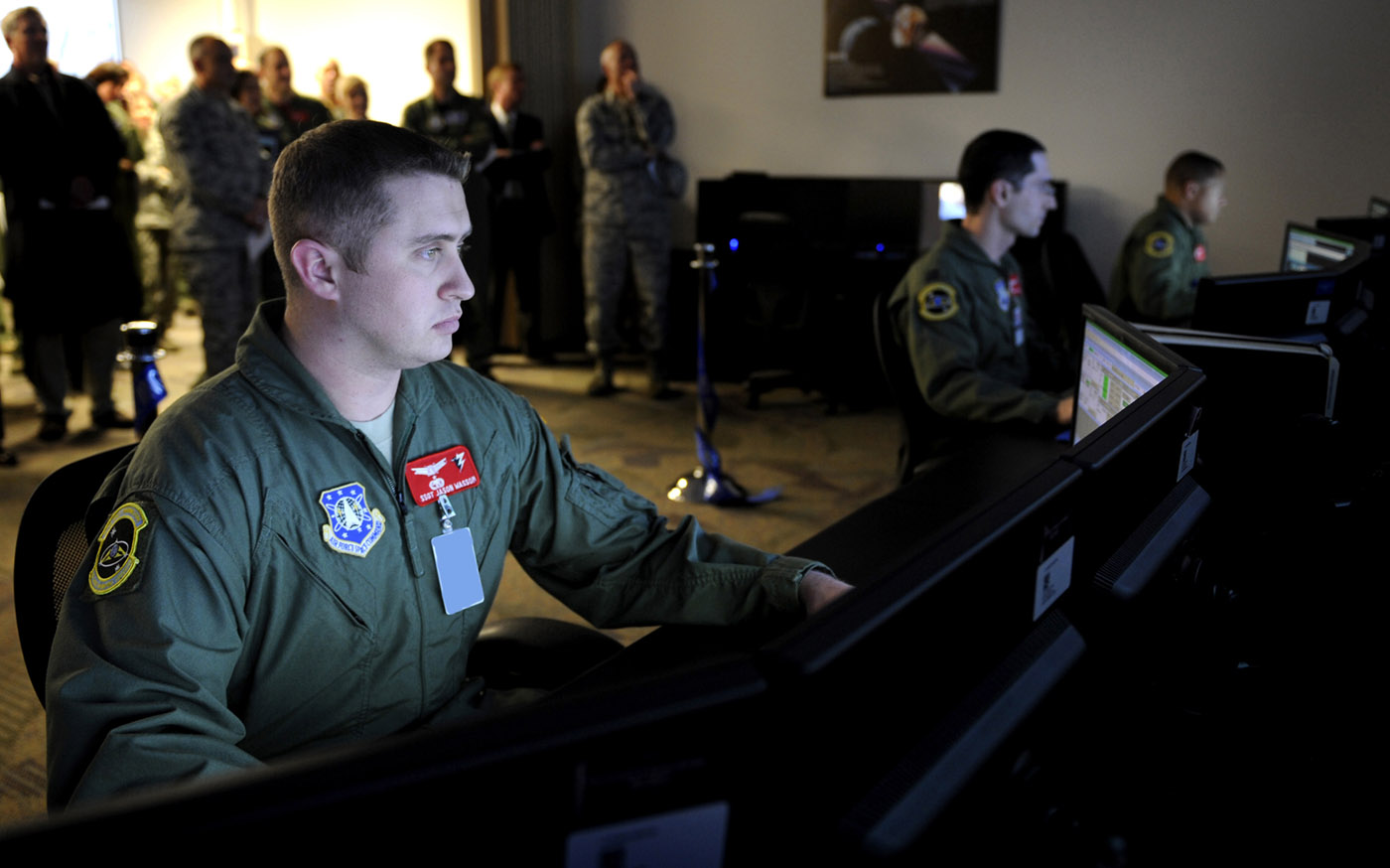 Staff Sgt. Jason Wassom, 3rd Space Operations Squadron, sits at a student station in the new Space Trainer Integrated Training Center following the ribbon cutting and official opening of the new system. (U.S. Air Force photo/Dennis Rogers)