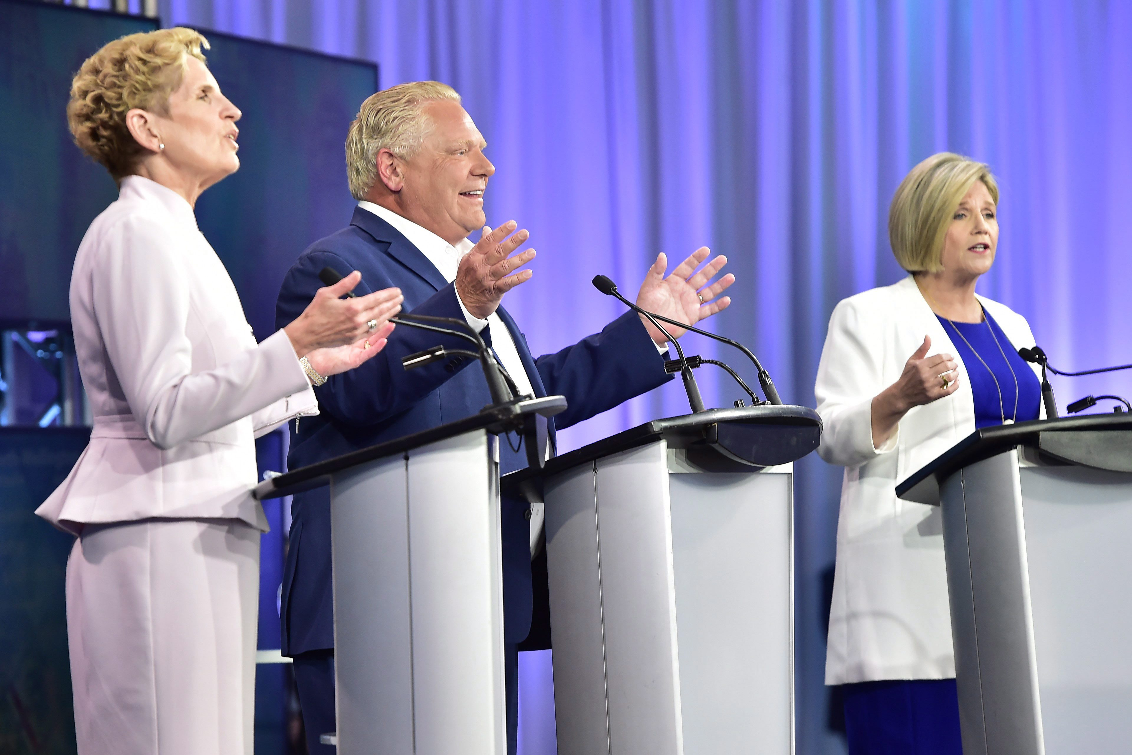 Ontario Liberal Leader Kathleen Wynne, left to right, Ontario Progressive Conservative Leader Doug Ford...