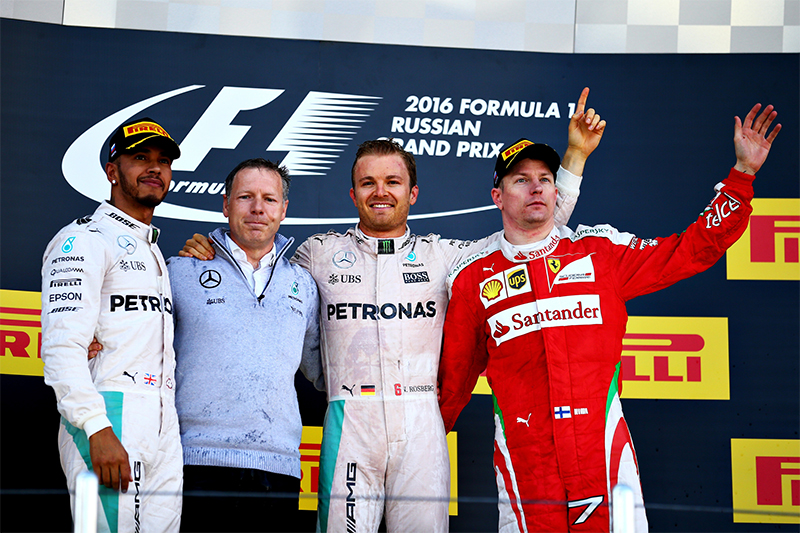 Russia's President Vladimir Putin, second from left, hands over the cup to winning German Mercedes driver Nico Rosberg as British Mercedes driver Lewis Hamilton, left, and Ferrari driver Kimi Raikkonen of Finland look on after the Formula One Russian Grand Prix at the Sochi Autodrom racetrack in Sochi, Russia, Sunday, May 1, 2016.