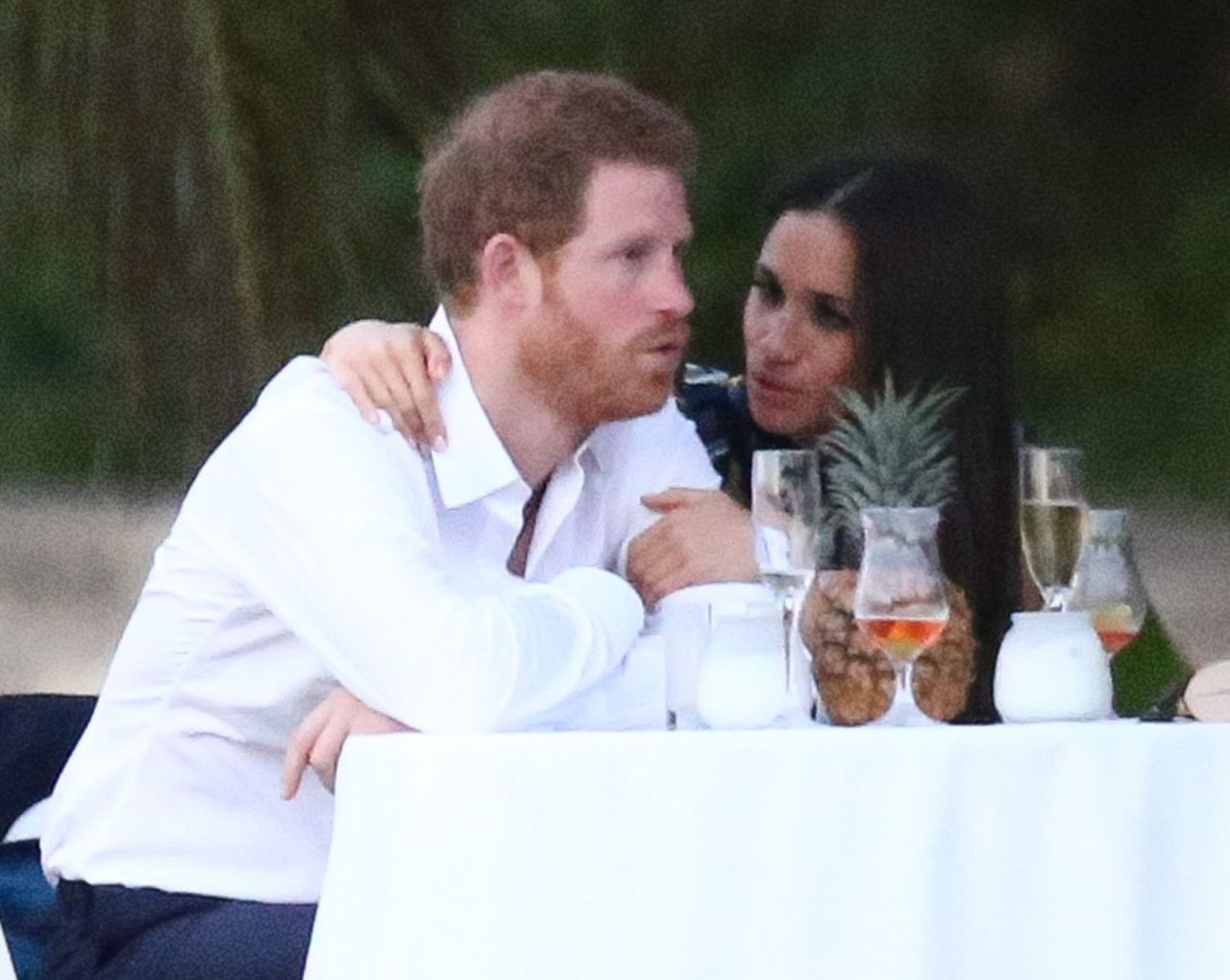 52334406 Royal couple Prince Harry and his girlfriend Meghan Markle were spotted attending a friend's wedding in Jamaica on March 3, 2017. Harry and Meghan enjoyed the festivities with the whole group before breaking off for some private conversation at a small table. Royal couple Prince Harry and his girlfriend Meghan Markle were spotted attending a friend's wedding near Jamaica on March 3, 2017. Harry and Meghan enjoyed the festivities with the whole group before breaking off for some private conversation at a small table. FameFlynet, Inc - Beverly Hills, CA, USA - +1 (310) 505-9876