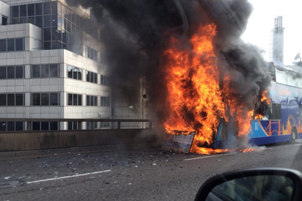 Tour bus bursts into flames in London
