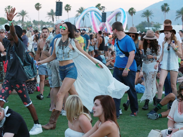 UK CLIENTS MUST CREDIT: AKM-GSI ONLY<BR/> Indio, CA - Reality star sisters Kendall and Kylie Jenner attend day 1 of the Coachella Music Festival and join Selena Gomez and a group of friends. The large group of girls dressed in Coachella fashion, high wasted denim shorts and some hippy inspired accessories. <P> Pictured: SGomez Kylie and Kendall Jenner <B>Ref: SPL737456  110414  </B><BR/> Picture by: AKM-GSI / Splash News<BR/> </P><P>