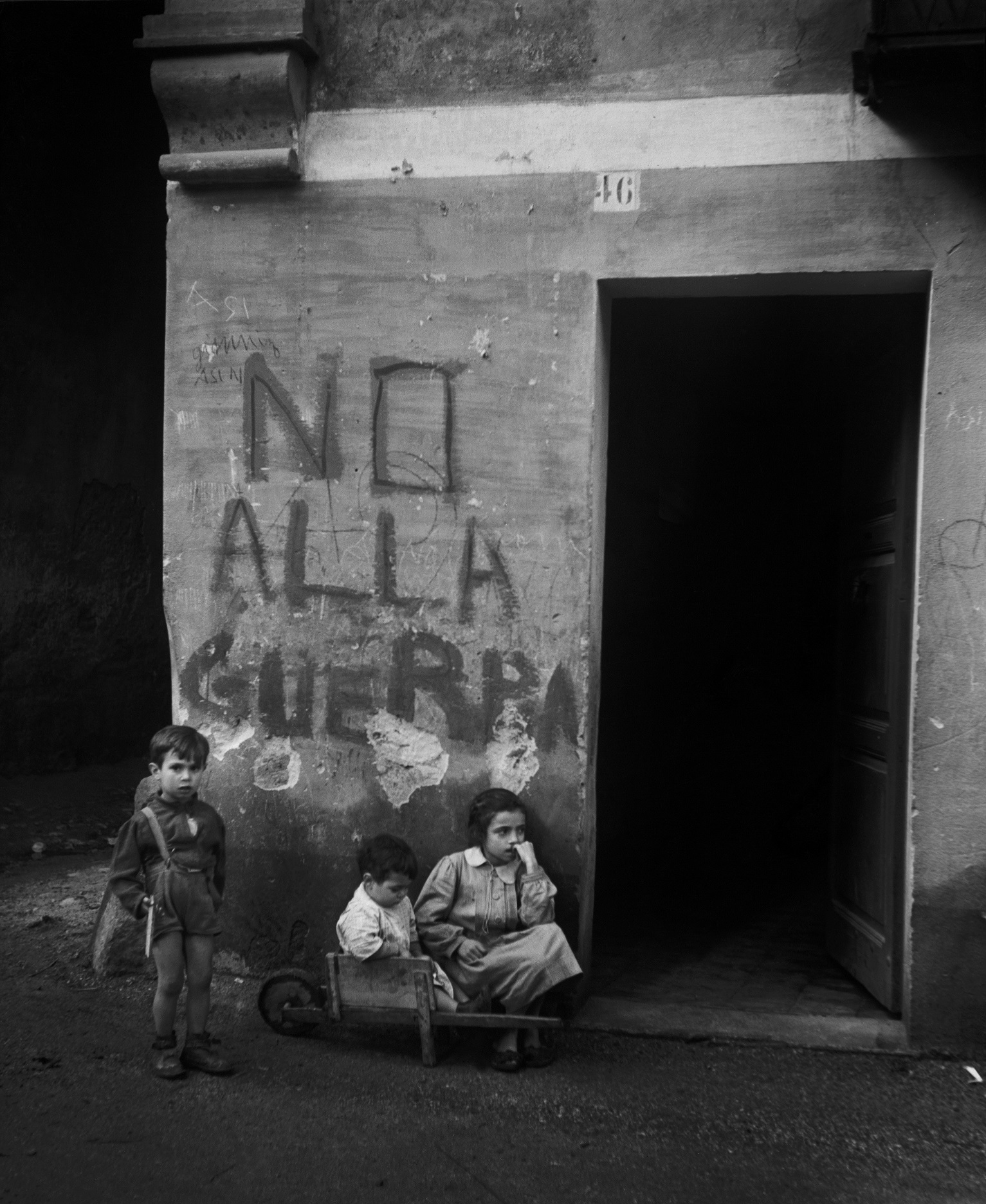 """ITALY. Genua. 1946. Writing on the wall: """"No alla guerra"""" (""""No to war""""). Italy was..."""
