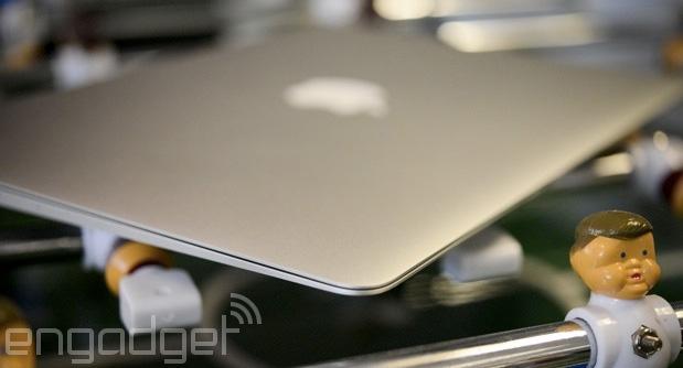MacBook Air on a foosball table
