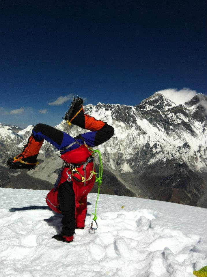 Di Westaway doing the world's highest handstand on the summit of Mt Ama Dablam,
