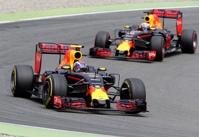 Australia's Red Bull driver Daniel Ricciardo, front, and Dutch Red Bull driver Max Verstappen steer their cars during the German F1 Grand Prix in Hockenheim, Germany, Sunday, July 31, 2016