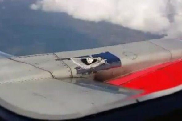 Mexico plane's engine hole patched up with tape - which then peels off