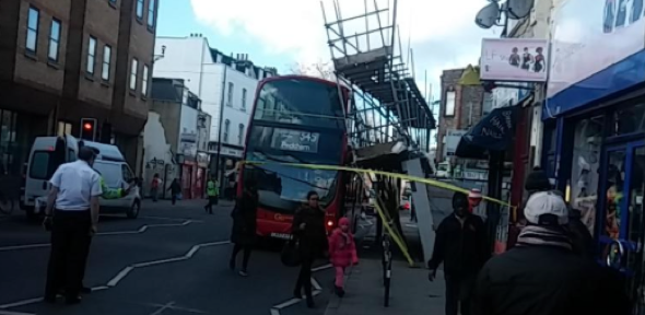 Scaffolding collapses on double decker bus in London
