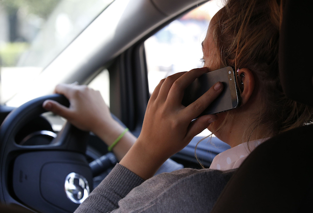 Embargoed to 0001 Thursday September 21 POSED BY MODEL File photo dated 13/08/14 of a woman using a mobile phone while driving. Millions of Britons may still be using their mobile phones while driving despite penalties for the offence being doubled, research suggests.