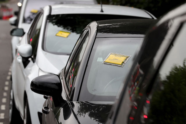 EMBARGOED TO 0001 MONDAY OCTOBER 2 File photo dated 19/07/17 of penalty charge notices affixed to several cars, as up to 17\% of parking spaces on UK streets could be freed up if drivers stopped parking badly, it has been estimated.