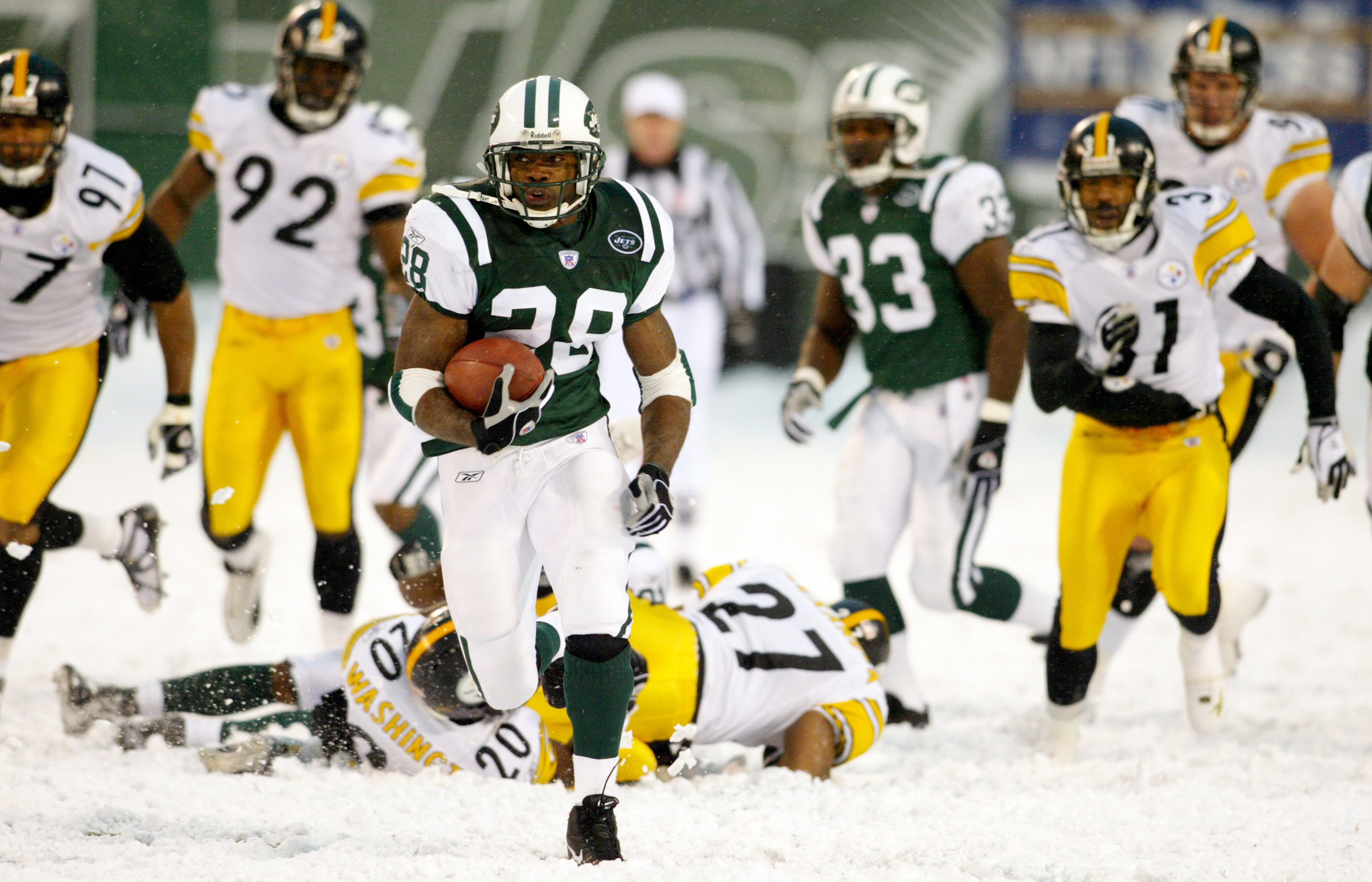 The New York Jets' Curtis Martin leaves a field of Pittsburg