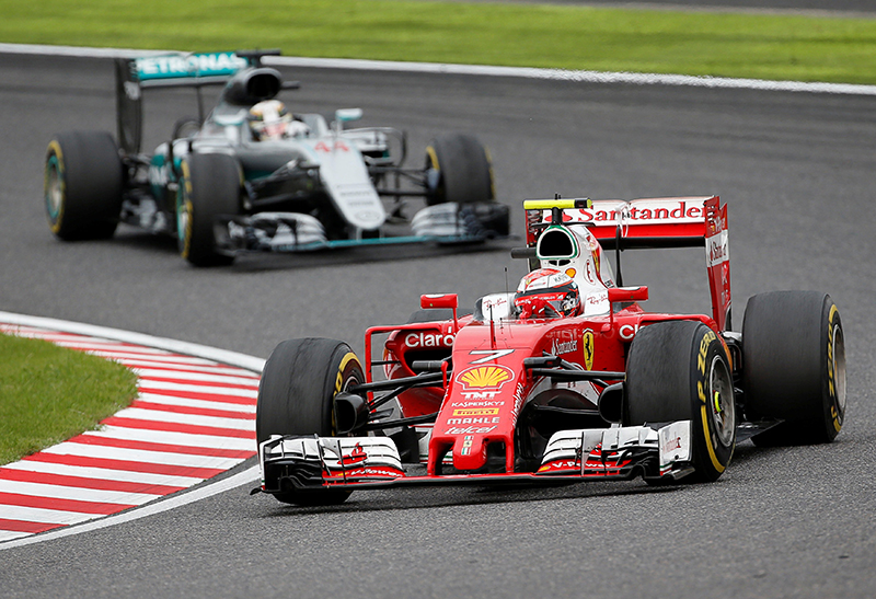 Ferrari's Kimi Raikkonen of Finland and Mercedes' Lewis Hamilton of Britain in action during the race.
