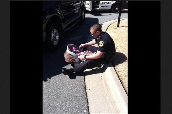 Officer comforting baby