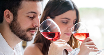 38053331 - close up portrait of young couple at wine tasting. man and woman smelling wine with eyes