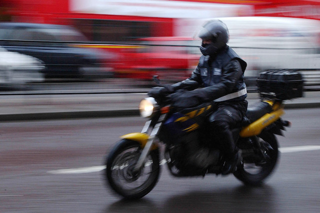 A motorcyclist on a bike on Euston Road in north London. PRESS ASSOCIATION PHOTO. Picture Date: Monday February 12, 2007. Photo credit should read: Joel Ryan / PA