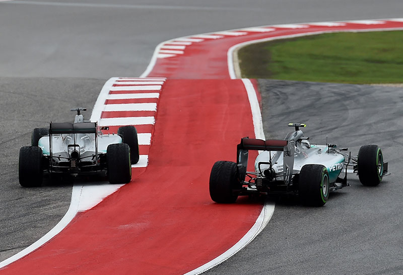 Lewis Hamilton and Nico Rosberg take the first turn at the US Grand Prix.