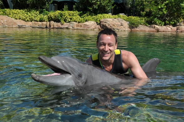 John Terry goes swimming with dolphins in Florida