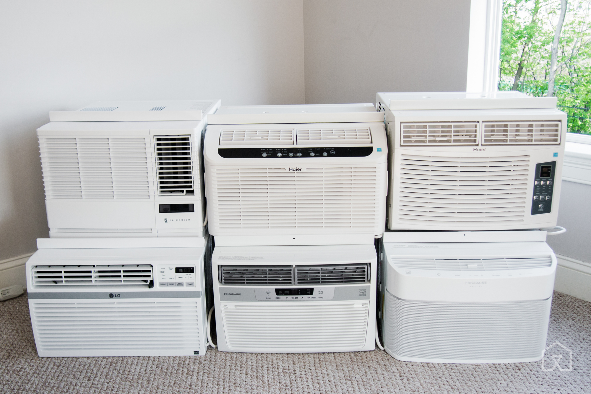 The air conditioners we tested in 2016. (Note: Stacking them in this  #4F8A41