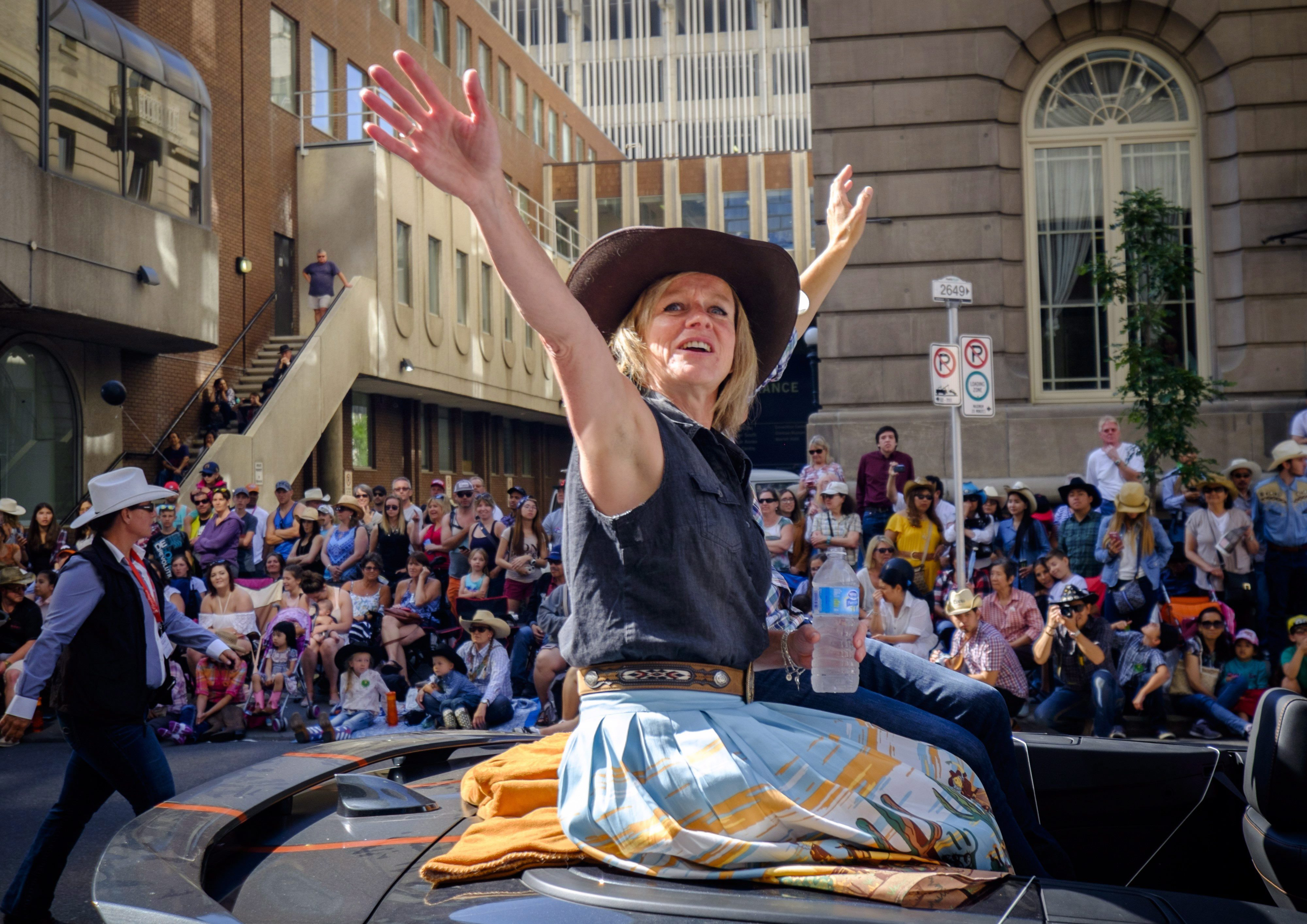 Alberta Premier Rachel Notley waves to the crowds during the Calgary Stampede parade in Calgary, Friday,...