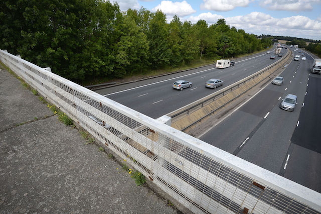 "Goose Lane bridge which goes over the M11 motorway near Birchanger which was closed after a van driver was killed in a motorway crash after what ""appears to be a lump of concrete"" struck his windscreen and his vehicle hit a tree."