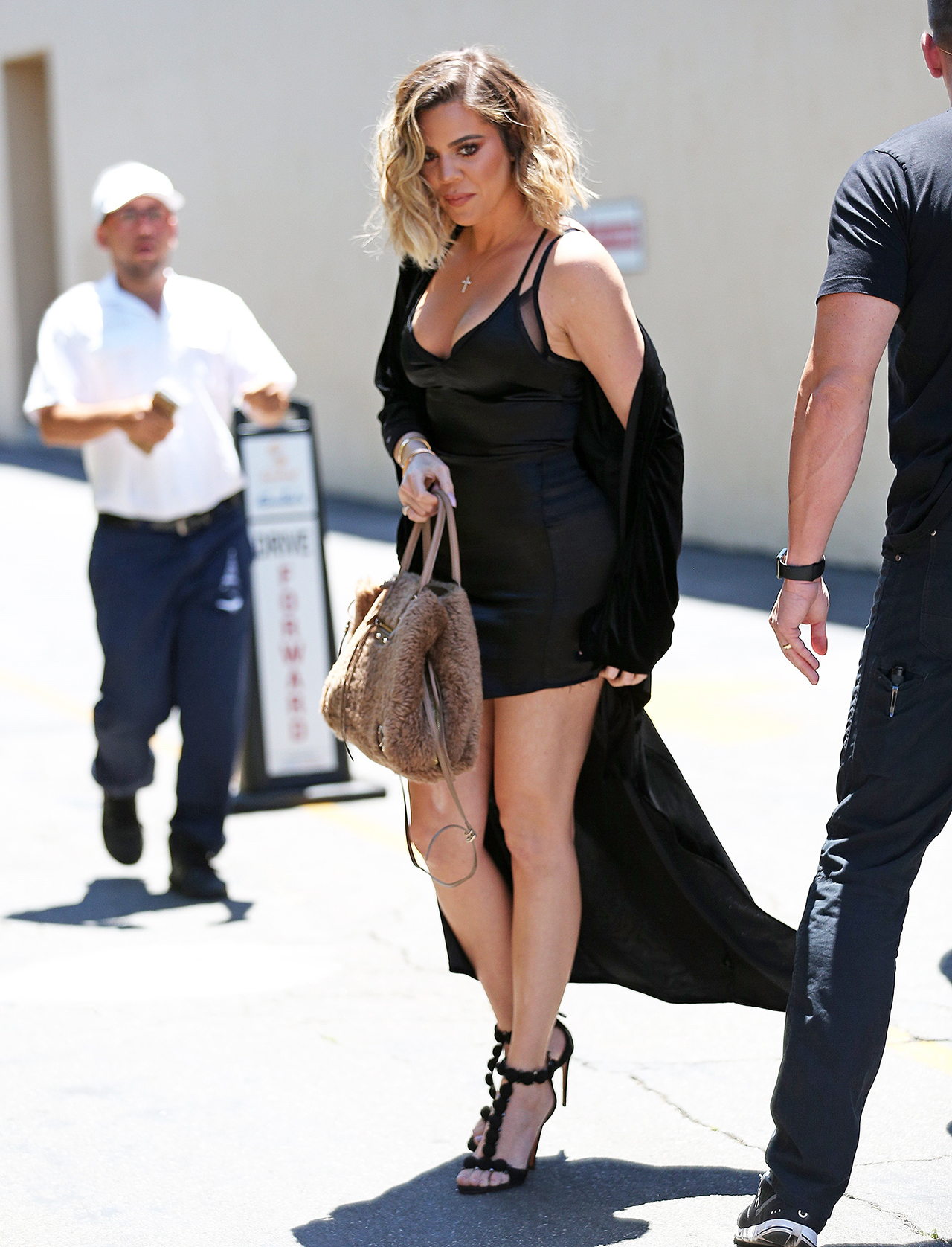 Calabasas, CA  - *EXCLUSIVE* Khloe Kardashian and Malika film at Emilio's Trattoria together. Khloe looks great in a little black dress and heels paired with a duster.  Pictured: Khloe Kardashian  BACKGRID USA 14 JUNE 2017   BYLINE MUST READ: CMaidana / BACKGRID  USA: +1 310 798 9111 / usasales@backgrid.com  UK: +44 208 344 2007 / uksales@backgrid.com  *UK Clients - Pictures Containing Children Please Pixelate Face Prior To Publication*