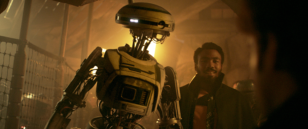 Donald Glover is Lando Calrissian and Phoebe Waller-Bridge is L3-37 in SOLO: A STAR WARS STORY.