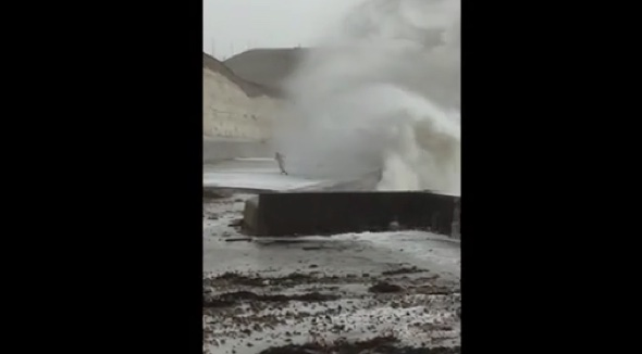 Streaker risks life playing chicken with 50ft storm wave in Brighton