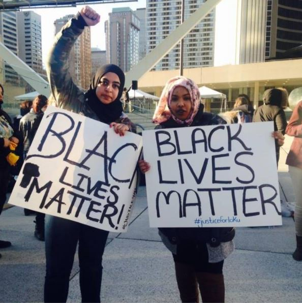 Masuma Asad Khan pictured with Dalhousie student union president Amina Abawajy holding Black Lives Matter...