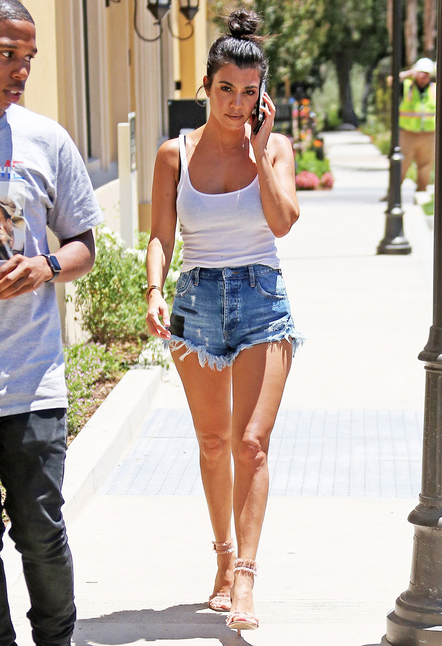 Calabasas, CA  - Kourtney Kardashian shows off her legs in daisy dukes while out running errands on a sunny Summer day. Kourtney paired the denim shorts with a white tank top and pink frilly heels.  Pictured: Kourtney Kardashian  BACKGRID USA 19 JUNE 2017   BYLINE MUST READ: CMaidana / BACKGRID  USA: +1 310 798 9111 / usasales@backgrid.com  UK: +44 208 344 2007 / uksales@backgrid.com  *UK Clients - Pictures Containing Children Please Pixelate Face Prior To Publication*
