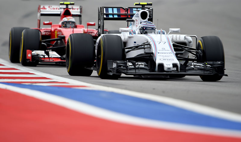 Ferrari driver Kimi Raikkonen chases the Williams of Valtteri Bottas at the 2015 Russian Grand Prix.