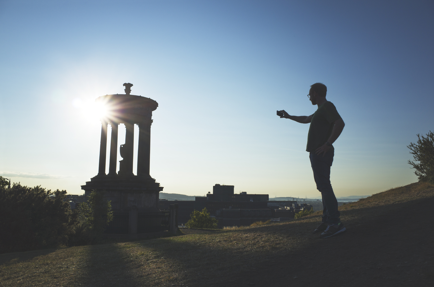 Person taking a photo at Calton Hill, Edinburgh