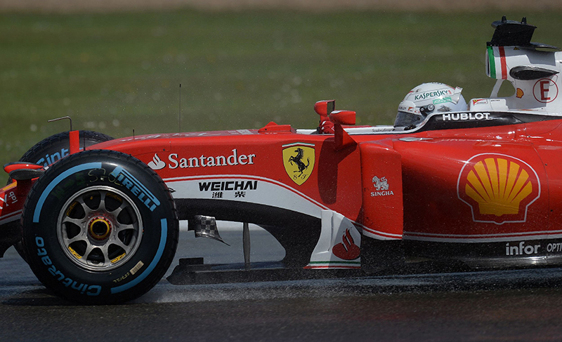 Ferrari's German driver Sebastian Vettel drives during the British Formula One Grand Prix at Silverstone motor racing circuit in Silverstone, central England, on July 10, 2016.