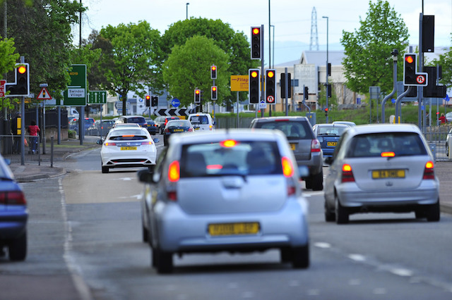 Traffic lights on the roundabout at the junction of Kingsditch Road and Tewkesbury Road part of the inner ring road in Cheltenham, Gloucestershire.
