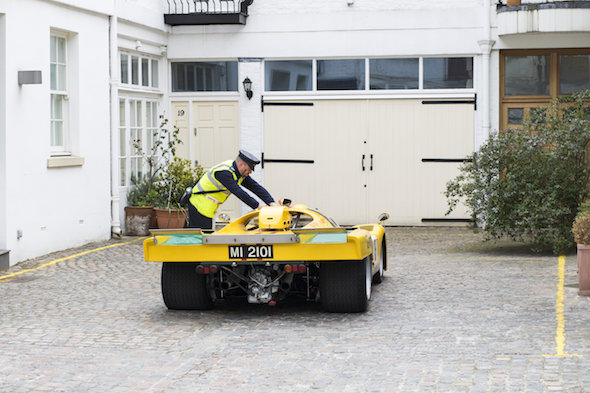 This is the moment a pair of traffic wardens slap a parking ticket on a £10 million Le Mans car while it is parked at the end of an empty mews.See SWNS story SWTICKET: The 1970 Ferrari 512M is one of the most desirable and valuable racing cars in the world - with models rarely coming onto the market. Classic car dealer Fiskens recently took one into stock and decided to take some photographs of it outside its Kensington headquarters. The dealership is based on a very quiet mews with no through traffic and they hoped they might be safe from the Royal Borough of Kensington and Chelsea's notoriously ticket-friendly wardens for a few minutes.