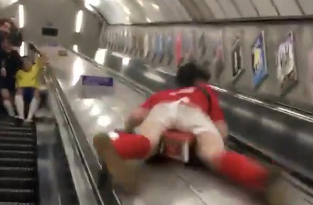 Boozed-up Brit slides down middle of Tube escalators - doesn't end well