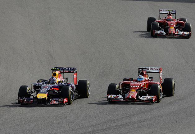 Daniel Ricciardo and Fernando Alonso race at the 2014 US Grand Prix.