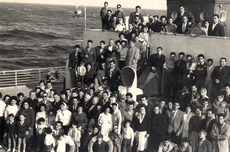 Italians aboard the S.S. Italia on their way to Canada, in