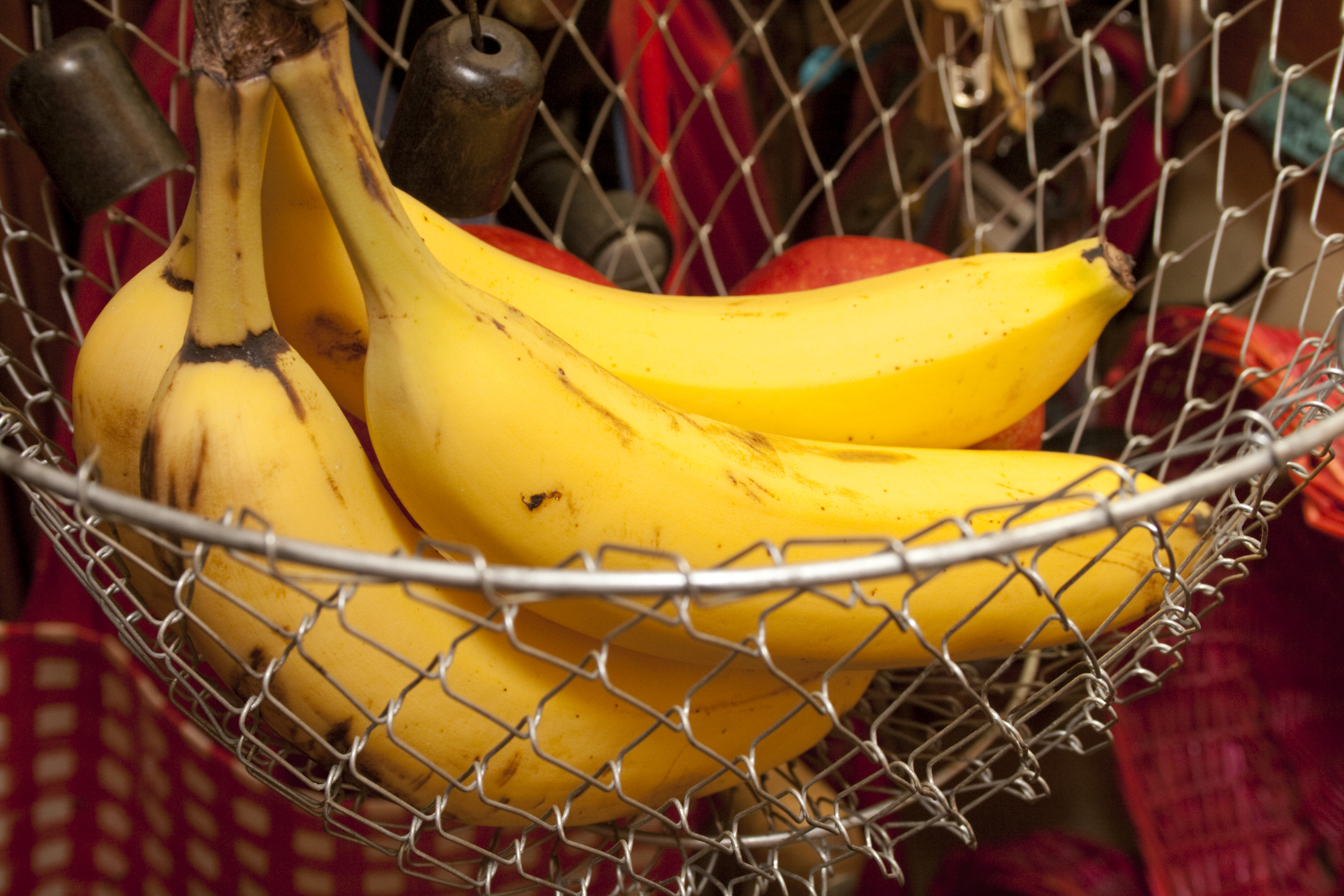 Yellow bananas in a kitchen basket