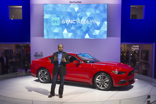 Raj Nair, Ford Motor Company's group vice president of global product development,  speaks in front of a 2015 Ford Mustang during the 2014 International Consumer Electronics Show (CES) at Las Vegas Convention Center in Las Vegas, Nevada, January 7, 2014. The new Mustang will be the first model in North America to feature the enhanced Ford SYNC AppLink system. The improvements include better voice control and simpler menus, a representative said. REUTERS/Steve Marcus (UNITED STATES - Tags: BUSINESS SCIENCE TECHNOLOGY)