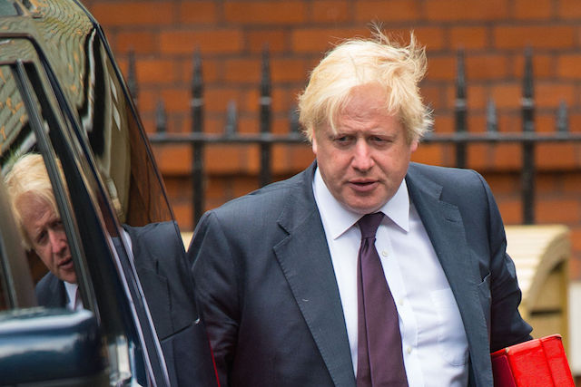Foreign Secretary Boris Johnson leaving his ministerial residence in central London.