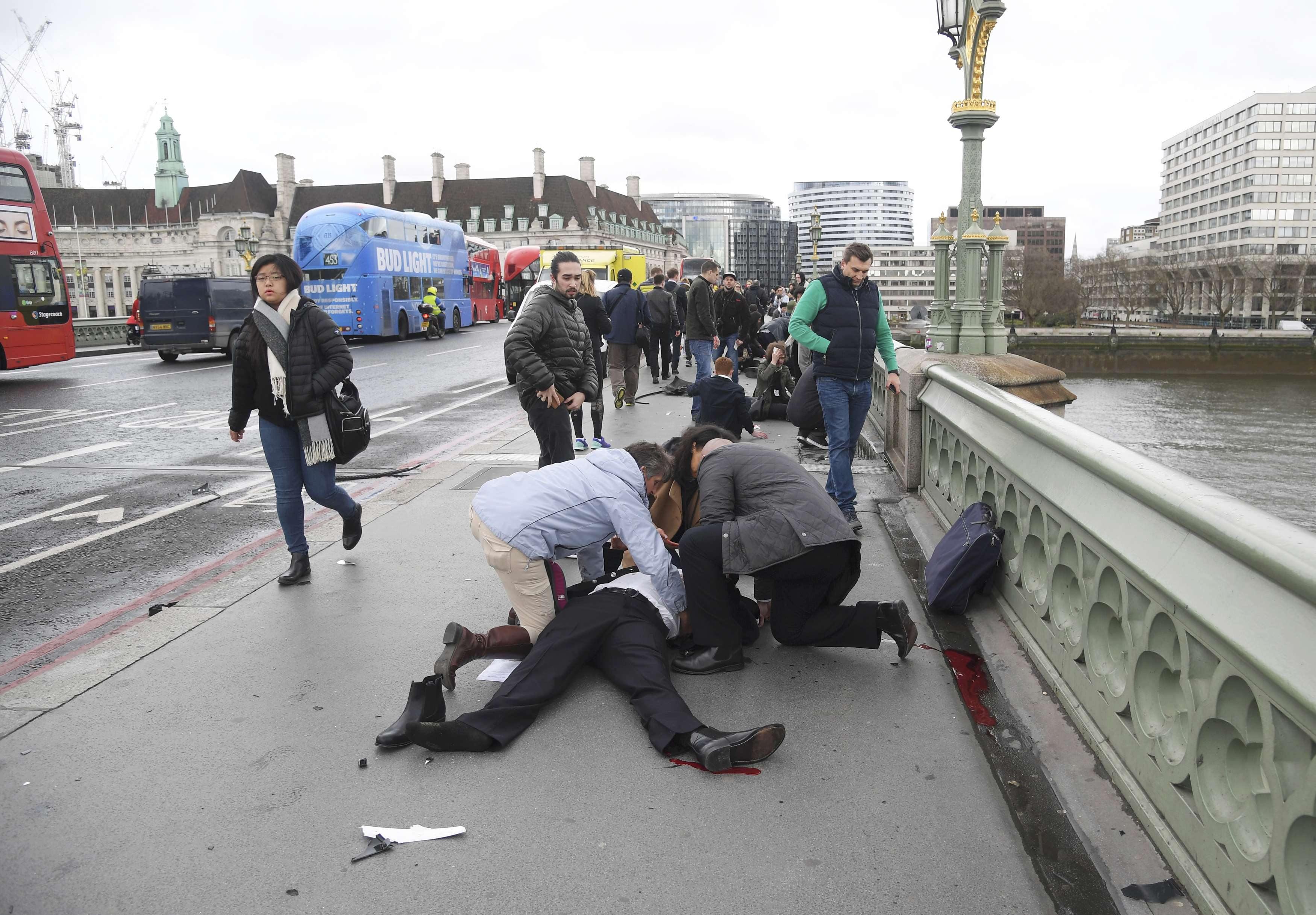 Injured people are assisted after an incident on Westminster Bridge in London, March 22, 2017. REUTERS/Toby