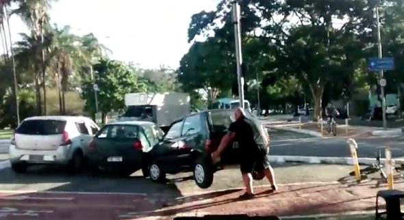 Brilliant moment huge cyclist moves car out of bike lane with bare hands (video)