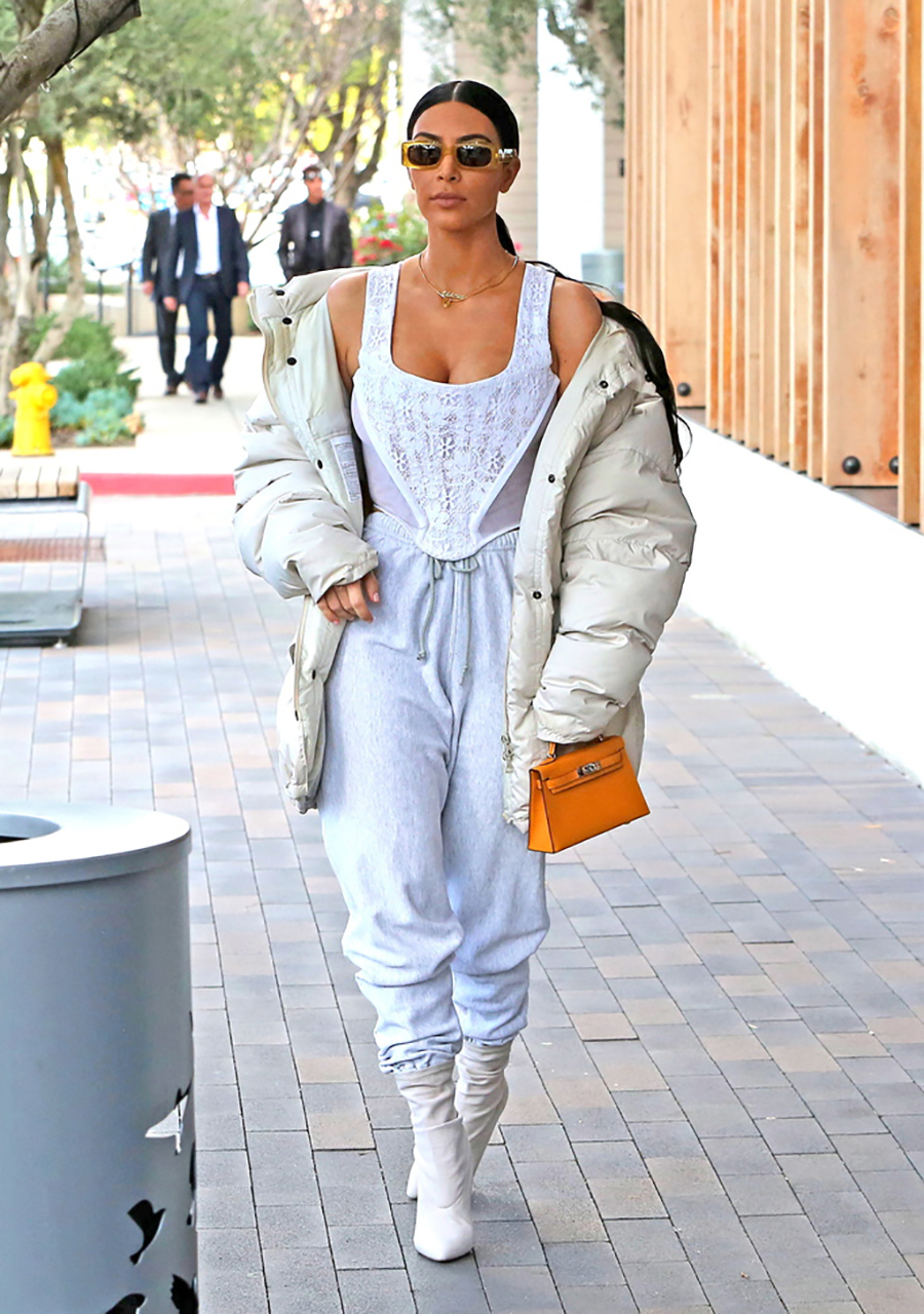 Wednesday, February 22, 2017 - Kim Kardashian flaunts her massive cleavage in a sheer white lace top, paired with a neutral bomber, grey sweatpants and neutral laced booties as she steps out for lunch with Kourtney and Kris and the KUWTK film crew in at Joey in Woodland Hills, CA. ROL-la-Jul/X17online.com