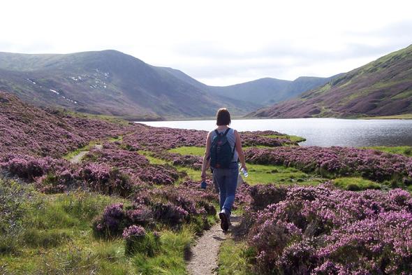 woman walking in cairngorms