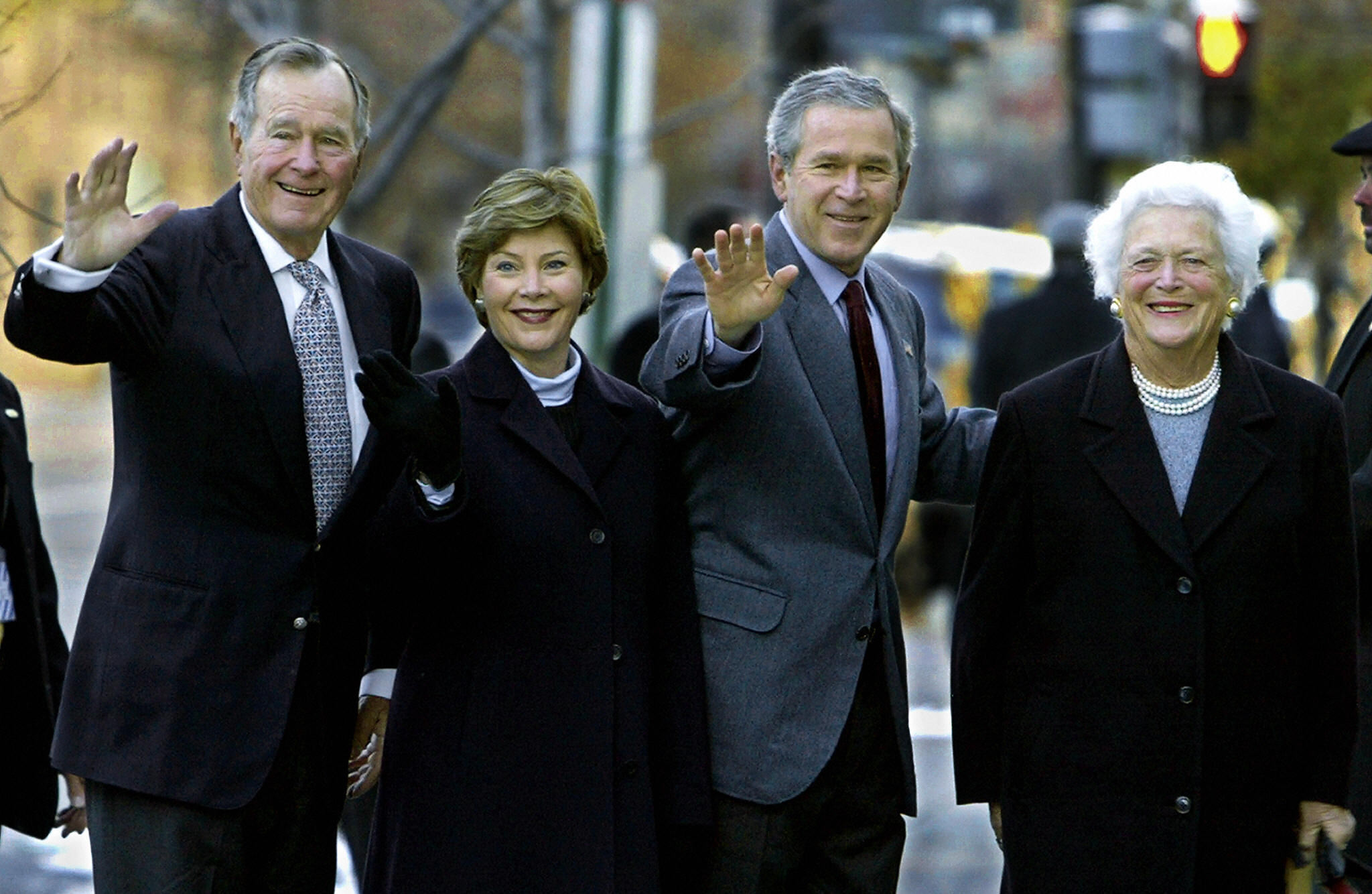 WASHINGTON, UNITED STATES:  Former US President George H.W. Bush (L) and his wife Barbara Bush(R) walk into St. John's Episcopal Church with their son US President George W. Bush(2nd-R) and his wife Laura to attend an early Sunday morning prayer service in 07 December 2003 in Washington. The historical church is a block away from the White House and has served various presidents for years.  AFP Photo/Paul J. RICHARDS  (Photo credit should read PAUL J.RICHARDS/AFP/Getty Images)
