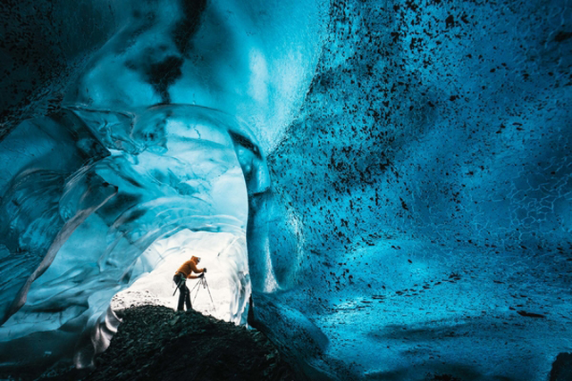 Wednesday 25th November 2015, Vatnaj�kull national park, Iceland: Photographer Mikael Buck with assistance from renowned local Icelandic guide Einar Runar Sigurdsson, explored the frozen world of Vatnaj�kull glacier in Iceland using Sony�s world first back-illuminated full-frame sensor � which features in the ?7R II camera. His images were taken without use of a tripod or any image stitching techniques in photoshop. This was made possible through Sony�s new sensor technology, allowing incredibly detailed low-light hand held photography. Previously images this detailed would have required carrying bulky equipment to the caves, some of which can require hiking and climbing over a glacier for up to two hours to to access.This picture: Inside the 'ABC cave' - which stands for Amazing Blue Cave.  Guide Einar Runar Sigurdsson is seen taking a photo at the entrance to the cavePR Handout - editorial usage only. Photographer's details not to be removed from metadata or byline.For further information please contact Rochelle Collison at Hope & Glory PR on 020 7014 5306 or rochelle.collison@hopeandglorypr.comCopyright: � Mikael Buck / Sony07828 201 042 / mikaelbuck@gmail.com